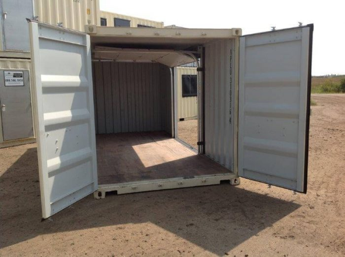 Shipping container with garage door entry