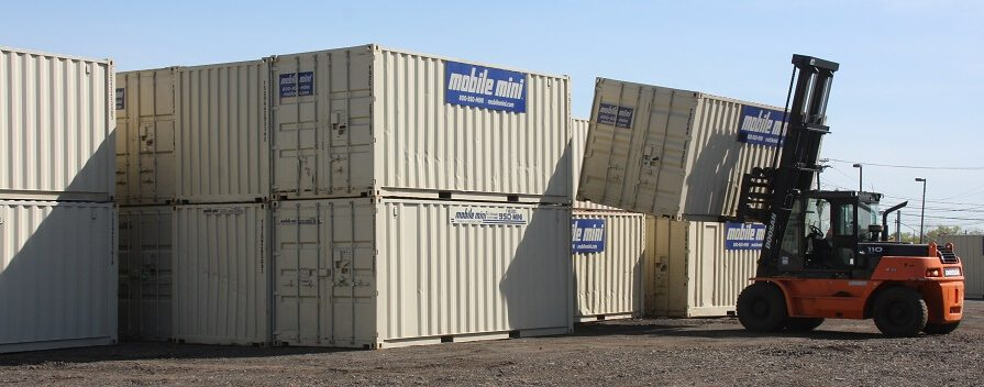 Mobile Mini storage containers, 40-footers, stacked by forklift