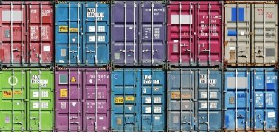 stack of colorful storage containers in shipping yard